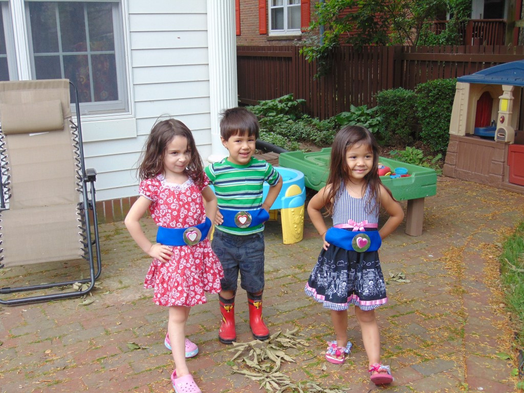 Kids wear superhero belts during play time!
